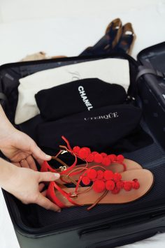 Image of packing Aquazzura pom pom sandals