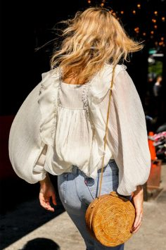 Image of Lucy Williams carrying round bag